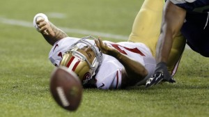 Colin Kaepernick fumbles the ball after getting hit by Seahawks Earl Thomas.