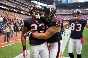 Arian Foster celebrates after scoring a touchdown vs the Denver Broncos