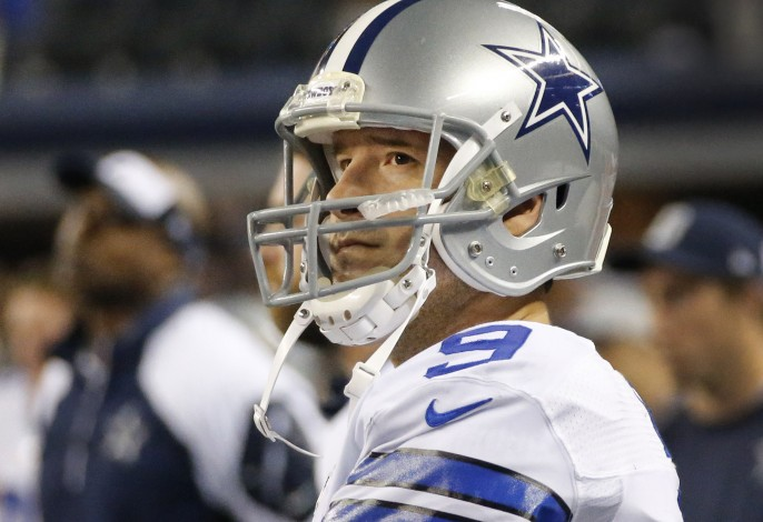 Tony Romo looks up at the score just before time expires. Cowboys lose a tough one in the final seconds of the game.