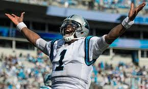 Cam Newton celebrates as he throws a 75yd touchdown pass.